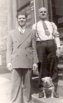 George and Mabel's engagement became official in 1940 and George posed with Tom and Pal on the front step of one of the confectionaries to mark the occasion.