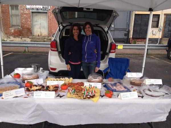 "Francesca Meluzzi & Elisa Chiarioni at the ""La Torta"" stand at the OV Farmers Market."