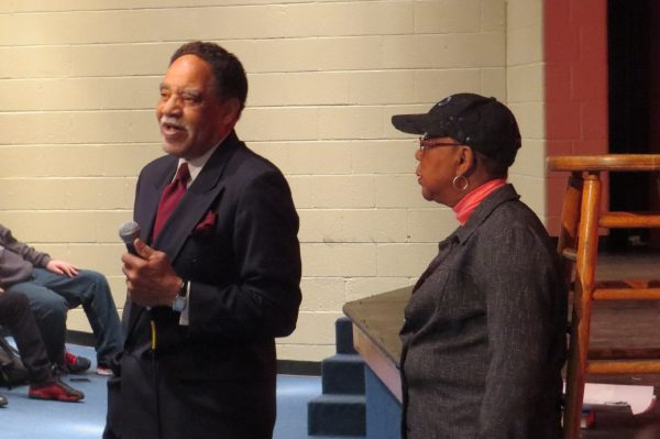 William Burrus, three-time president of the American Postal Workers Union, is shown speaking to Wheeling Park High School students.