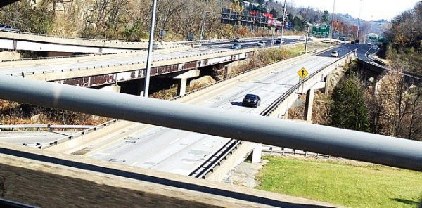 "Interstate 70 is reduced to one lane in both directions in the area of Wheeling Tunnel, leading officials of the state Division of Highways to designate the roadways as too dangerous to erect an ""Attraction Sign"" featuring advertisements for downtown businesses."