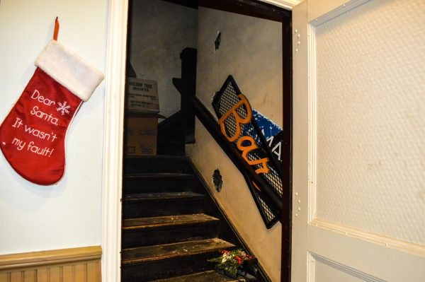 The stairwell to the three floors where the former Wheeling Hotel did business is located behind a door in the Bridge Tavern's meeting room.