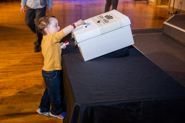 A young Wheeling child, Lewis McKinley, assisted his parents Bennett and Katy when the time arrived for the audience members to vote for their favorite presented project.