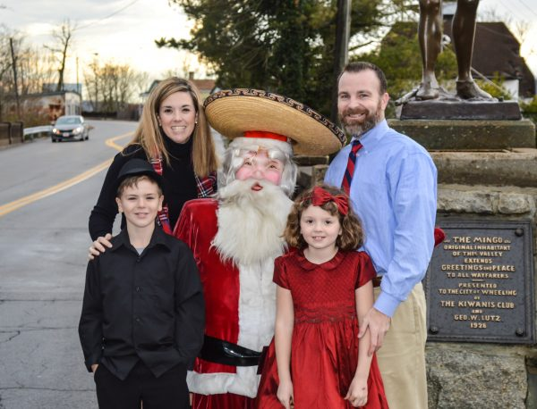 "The Ashmore family recently borrowed the ""Fiesta Santa"" that once attracted customers to Reichart's in downtown Wheeling. for a family portrait. Ben is now nine years old, and Sammie is seven."