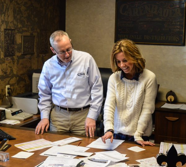 Carl Carenbauer and his daughter Erin review some of the donation requests the company receives on a daily basis.