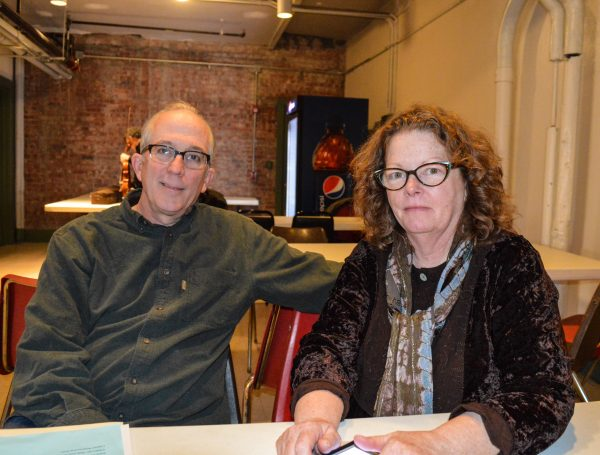 Rich Moore and his wife Mollie O'Brien taking a break in the Capitol Theatre basement during Saturday's rehearsal.