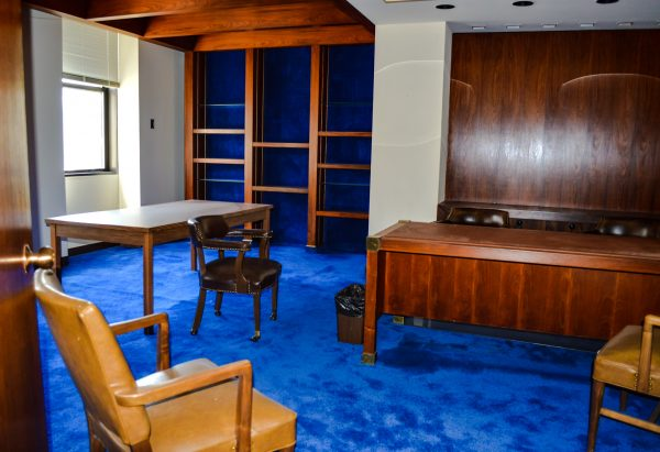 This fifth-floor office is the only one in the entire building that features royal blue carpet.