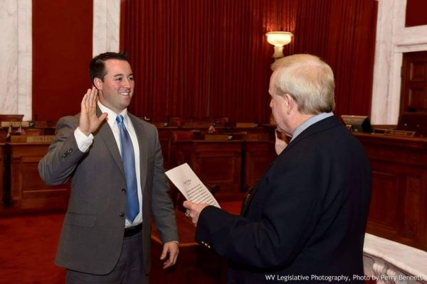 Del. Fluharty was sworn in as a West Virginia lawmaker by former House Clerk Greg Gray.