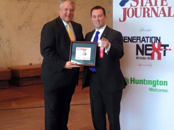 "Del. Fluharty was named to the State Journal's ""40 Under 40"" statewide listing, and accepted the honor from Senate President William Cole."