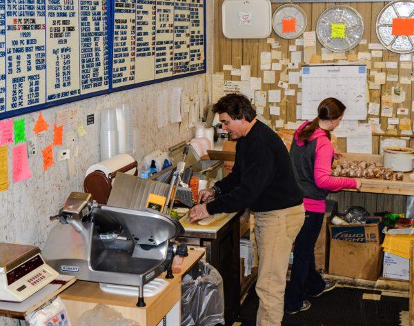 Lance Miller works behind the deli counter along with Megan Hoskins.
