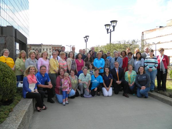 """Several employees of participating organizations gathered outside of downtown Wheeling's Wesbanco Bank to discuss this year's """"Amazing Raise."""""""