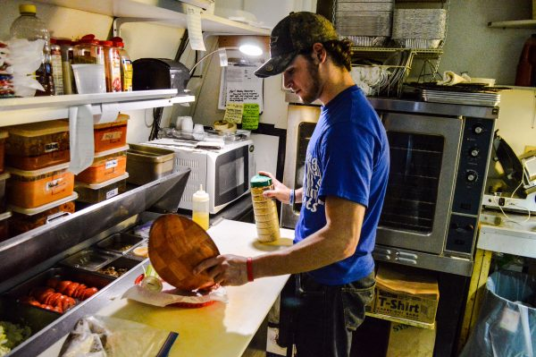 Dustin Schrump works the kitchen at the 19th Hole.