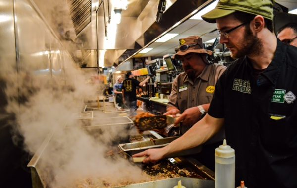 Ozzie Hyde, Quaker Steak GM, worked the line to help put the final touches on the pulled pork.