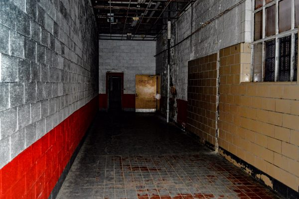 "This hallway is where the legendary ""Shadow Man"" was photographed a few years ago. ... Is that an orb? Because it's not a dusty camera lens."