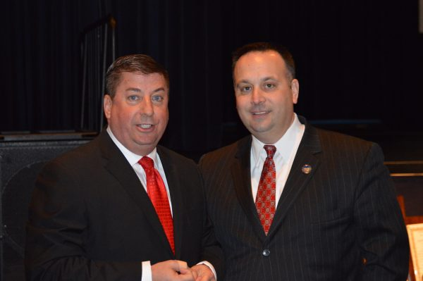 Mayor Andy McKenzie, on right with Council member Gene Fahey, is beginning his eighth and final year in the position.