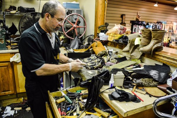 Campeti repairs between 50 and 100 pairs of shoes each week.