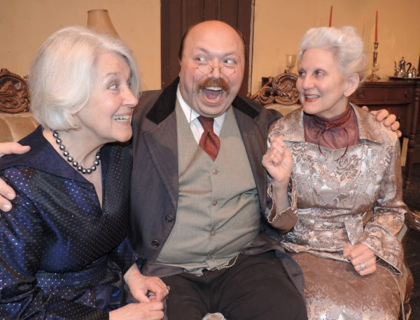 "Gael Finchum, left, and Cathie Spencer, right, played Abby and Martha Brewster, and Justin Swoyer, center, played Teddy Brewster in Towngate's recent production of ""Arsenic and Old Lace."""