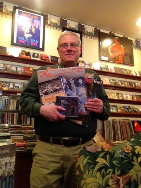 Books & Music owner and operator, Alan Lestini, shows of some of his merchandise.