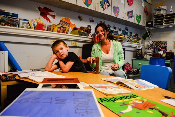 """Therapist Megan McGee instructs a student in the """"mock school"""" setting at the Augusta Levy Learning Center."""