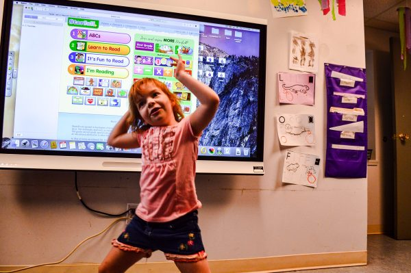 Augusta Levy student Andrienne Oszust dances while working with one of several computer programs utilized at the learning center.
