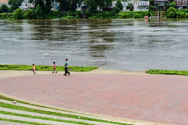 The Ohio River rose over last weekend, covering the lower area of Heritage Port and causing officials of the Multicultural Festival to move its live entertainment to 12th Street.