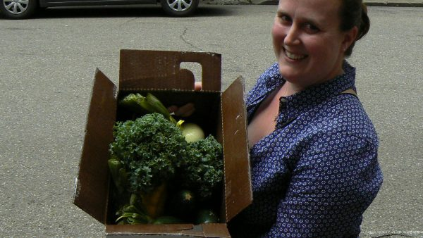 Wheeling resident Hope Coffield was anxious to pick up her box of locally grown foods as a subscriber of the Community Supported Agriculture program.