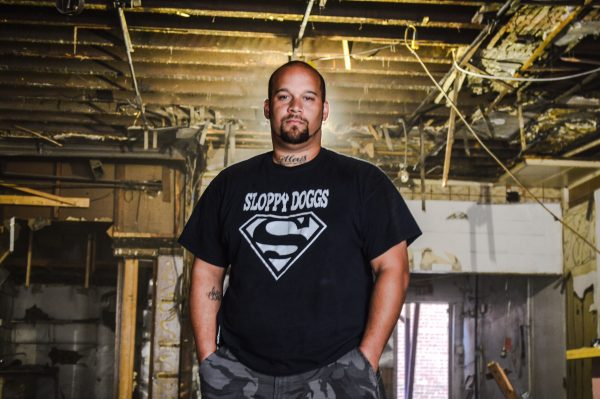Christopher Burress, owner of Sloppy Dogs in downtown and in the Elm Grove section of Wheeling, plans to consolidate his location inside the former Dinner Bell.