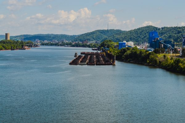 Visitors walking the Bellaire Bridge get a view of the barge activity involved with Murray Energy.