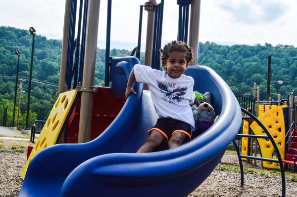 Two-year-old Jackie Byrd enjoys one of the slides at the new Elks Playground in East Wheeling.