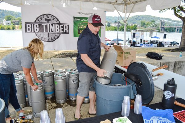 Matt Kwasniewski and Amber Roberts prepare for the annual Mountaineer Brewfest in Wheeling.