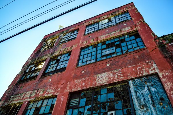 Vandals have shattered many windows of the former factory.