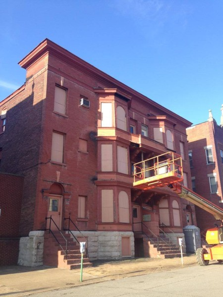 The redevelopment of the Riley Flat building will be complete in Spring 2016. This is how the building appeared at the time Slack's company purchased it.