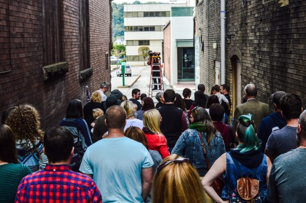 "Nearly 100 local residents attended Bennett McKinley's final ""Meet Me in the Alley"" photo shoot in downtown Wheeling."