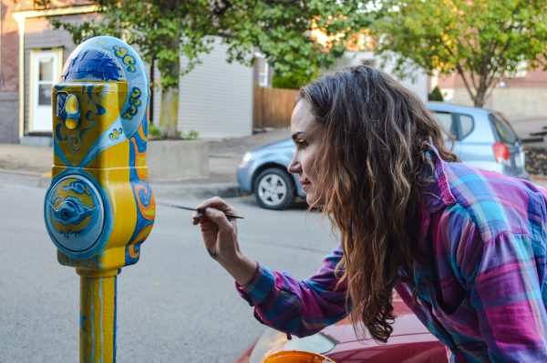 Wheeling artist Patricia Croft works on her parking meter on the east side of Centre Market.