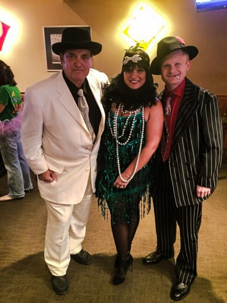 Representatives of the Wheeling Convention and Visitors Bureau - (from left to right) Frank O'Brien, Olivia Litman, and Michael Biela, adopted the Mobster theme for the Governor's Conference Halloween Party at the former West Virginia Pen.