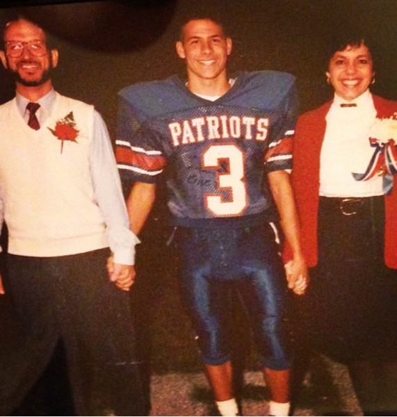 Matt DiLorenzo during his Wheeling Park football days, posing with his parents