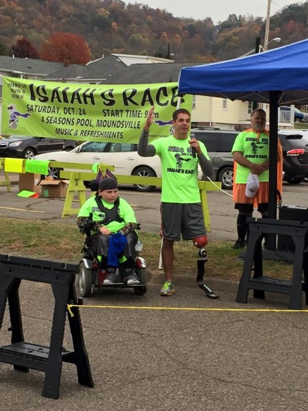 "Anderson, joined by Isaiah Leasure of MOundsville, speaks to the large crowd that participated in ""Isaiah's Race"" on Oct. 24 in Moundsville."
