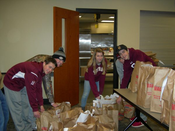 More than 20,000 food items were donated last year and Robert Kahle, Clayton McCabe, Emily Emmerth, and Matt Turziano were a few of the students to put in the hard work at the 18th Street Neighborhood Center.