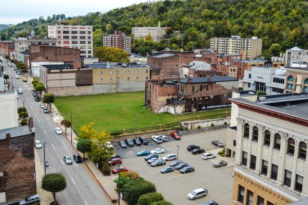 The last two standing buildings in the 1100 block of downtown Wheeling will be soon razed to make way for The Health Plan's new headquarters.