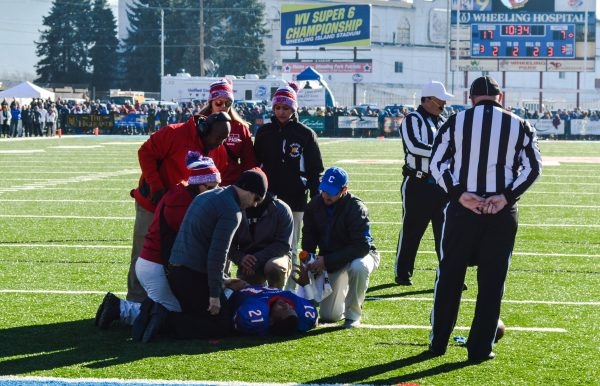 His separated shoulder was returned to its socket on the turf of Wheeling Island Stadium.