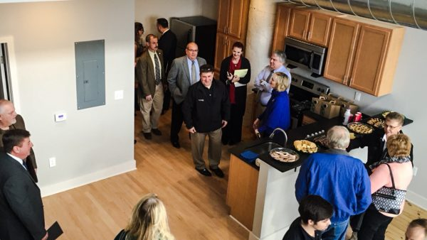 The Woda Group and the Regional Economic Development Partnership held the grand opening yesterday for the Stone Center Lofts.