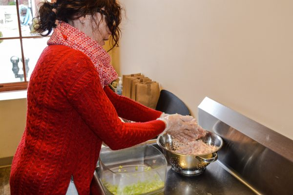 Staff member Cindy Lewis prepares the chicken salad prior to lunch time.