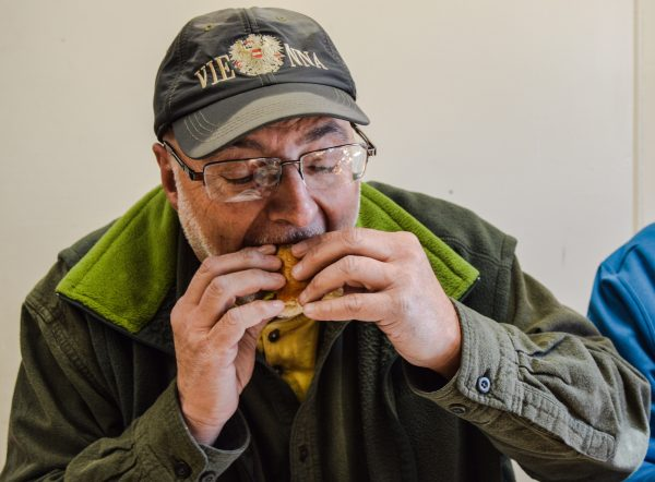 Gregg Boury bites into a replica of his all-time favorite - the Slim Jim - at Bob's Lunch.