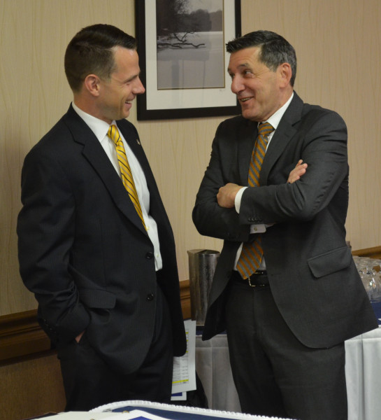 U.S. Attorney Bill Ihlenfeld discussing the drug epidemic with White House Office of National Drug Control Policy Director Michael Botticelli at a June 2015 Prescriber Education Conference designed by our office.
