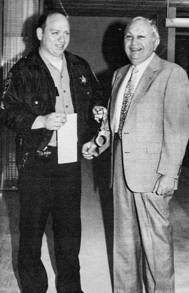 Former Ohio County deputy Charlie Murphy (a current Ohio County magistrate today) arrested Ellis Boury as part of a fundraising event in the 1980s.