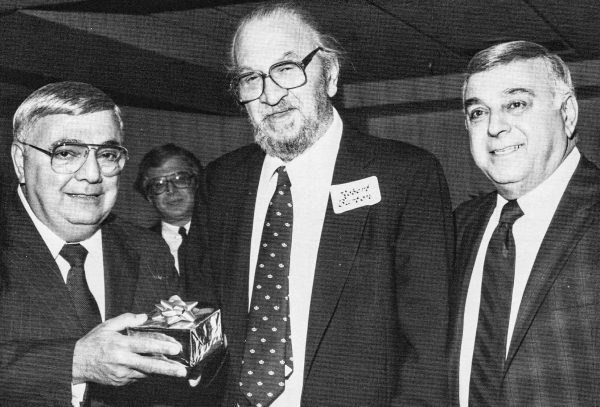 Robert O. Burton (center) designed Elby's restaurants for 14 years and when he retired George and Mike Boury presented him with a special gift.