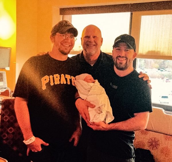 Palmer's son, Cory and Eric, visit with Cory's son, Noah. The new addition came along on Nov. 4, 2015.