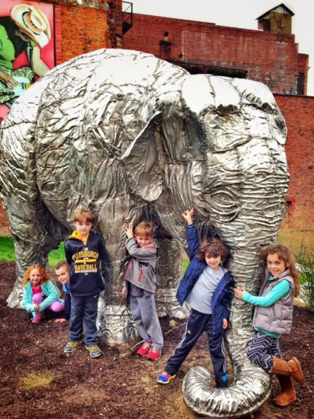 "Several of the children who visit the Children's Museum get the chance t visit with ""Bobo"" at Heritage Port Park in downtown Wheeling."