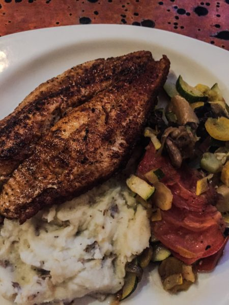 Cajun catfish, sauteed vegetables, and mashed red potatoes is a favorite plate at the Wheeling Brewing Company.