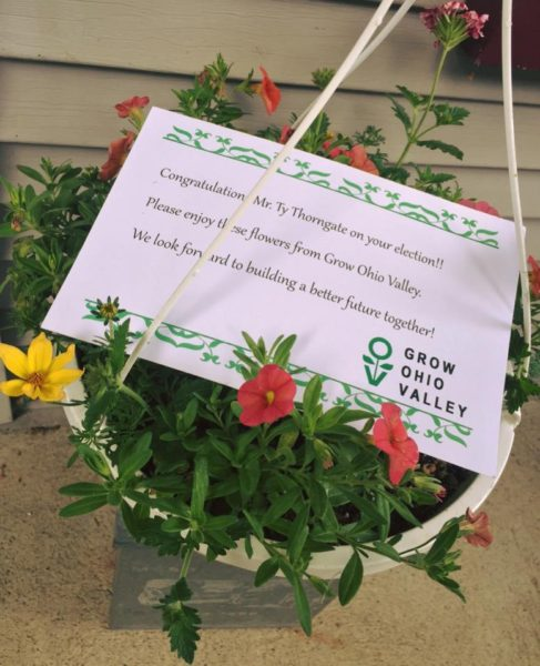 Officials of Grow Ohio Valley offered flower baskets to each of the winners in Wheeling's elections.