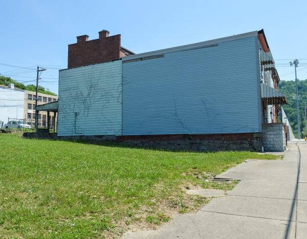 The vacant lot now adjacent to the buildings will be transformed into an outdoor dining area.